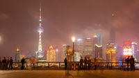 People on The Bund waterfront in Shanghai at night