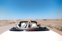 Happy couple enjoying road trip
