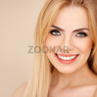 Smiling blond with bare shoulders
