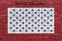 flag of Goldfield, Colorado painted on brick wall