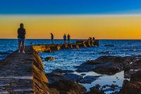 People at Breakwater, Montevideo Uruguay
