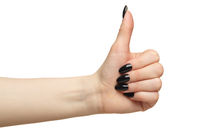 Female hands with black nails manicure with thumb up  isolated on white background.