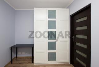 Modern apartment interior with wardrobe