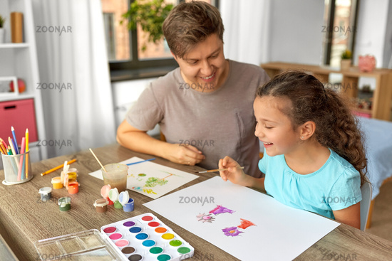 happy father with little daughter drawing at home