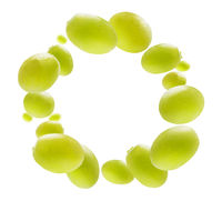 Green grapes levitate on a white background