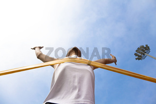 Winning athlete with cloud background