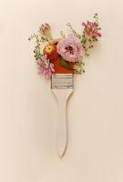 Paintbrush with organic fresh flowers