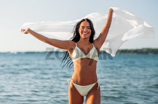 woman in bikini swimsuit with cover-up on beach