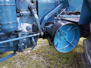 Belt drive wheel on a tractor