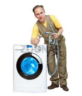 The repairman near the washing machine