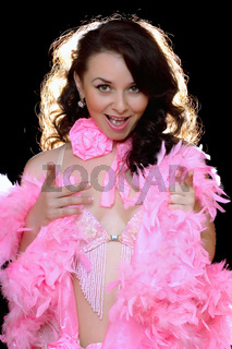 Portrait of beautiful young woman in pink dancing dress