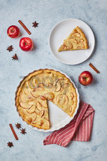 Homemade apple pie with sour cream filling on light background, top view.