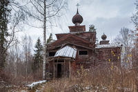 old dilapidated wooden church in the woods.