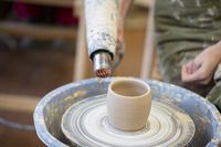 Clay vase on a potter's wheel. Working with clay