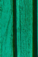 Macro texture of old faded paint on wooden timber planks