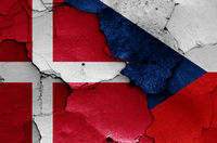 flags of Denmark and Czechia painted on cracked wall