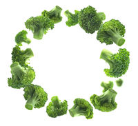 Green broccoli levitating on a white background