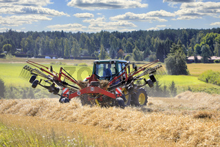 Working with Tractor and Rotary Rake