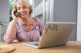 Happy woman using her laptop