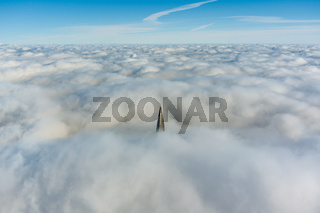 Russia, St. Petersburg, 14 October 2021: The top of the tallest skyscraper in Europe above the clouds, the building of the Gazprom oil company, the spire of a metal and glass structure