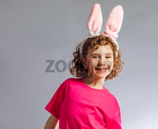 the little girl with pink bunny ears on Easter day