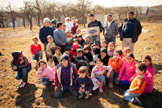 SEREDNIE, UKRAINE - MARCH 09, 2011: more successful members of Roma community support most vulnarable