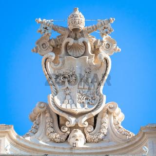 Antique Vatican symbol located in Saint Peter Square, Rome, Italy