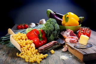Vegetables, bacon and cheese for cooking pasta.