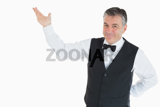 Smiling man pointing to something