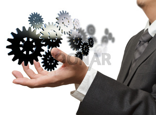 Businessman shows gear to success on white background