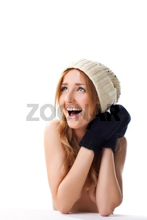 Happy blond woman in mitten and cap