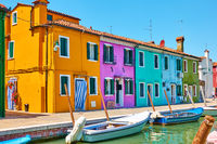 Cozy colorful houses by canal in Burano Island in Venice