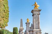 Golden statues on Alexandre III bridge