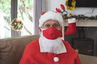 Portrait of Santa Claus wearing face mask