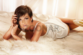 Sensual brunette woman lying and posing