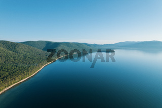 Summertime imagery of Lake Baikal is a rift lake located in southern Siberia, Russia Baikal lake summer landscape view from a cliff near Grandma's Bay. Drone's Eye View.