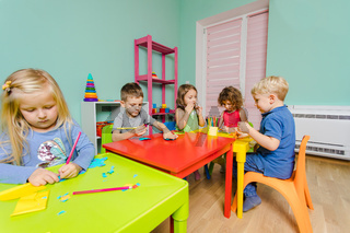 the kids create bright things together in the kindergarten