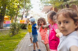 Lovely children playing outdoors at summer camp