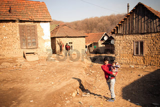 SEREDNIE, UKRAINE - MARCH 09, 2011: Young families surviving in not suitable for life settlements