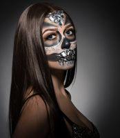 Santa Muerte. Pretty young woman with face art
