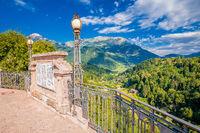 Cremeno bridge and Dolomites Alps landscape view