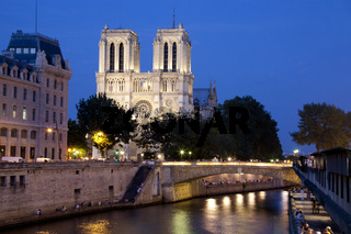 Notre Dame Cathedral and the river Seine at night