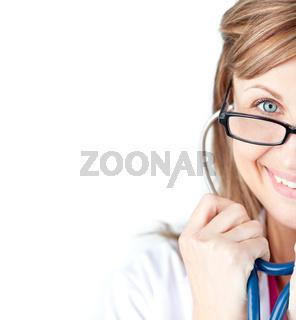 Sparkling female doctor holding sthetoscope against white background