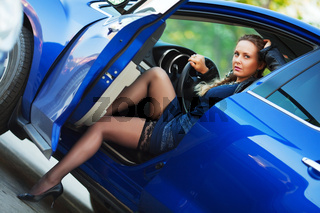 Young woman in a sports car