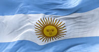 Close-up view of the national flag of Argentina waving in the wind. Horizontal striped flag in light blue color and the May Sun in the center. South American state. Democracy and independence.