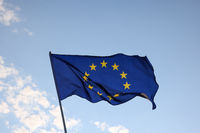 European Union EU flag waving in clear blue sky