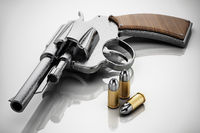 Generic revolver and bullets with soft reflection. 3D illustration