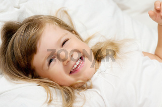Close-up portrait of smiling little girl