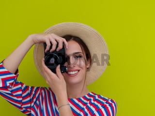 Portrait of beautiful female photographer shooting close up