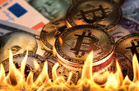Bitcoin and paper money in fire flames